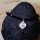 Fasetted spinel stone bracelet with silver medal .